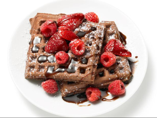 Chocolate Waffles with Chocolate Syrup Ingredients 3 tablespoons unsalted butter 3 tablespoons vegetable shortening 2 cups all-purpose flour 1 tablespoon baking powder 1/4 teaspoon salt 3 tablespoons sugar 3 large eggs 1 cup milk 1/2 cup chocolate syrup, plus more for topping 1/2 teaspoon vanilla extract Cooking spray Confectioners' sugar and/or berries, for topping (optional) Directions  Melt the butter and shortening in a small saucepan, stirring to combine; remove from the heat and set aside. Whisk the flour, baking powder, salt and sugar in a large bowl. Whisk the eggs, milk, chocolate syrup and vanilla in a large liquid measuring cup or a separate bowl. Whisk the egg mixture into the flour mixture until combined. (The batter will be slightly lumpy.) Whisk in the butter mixture until combined. Preheat the oven to 250 degrees F. Preheat a waffle iron and spray with cooking spray. Ladle some of the batter into the waffle iron to within an inch of the edge (1/3 to 1/2 cup batter, depending on your waffle iron); cook until crisp. Transfer the waffle to a baking sheet and keep warm in the oven. Repeat with the remaining batter. Divide the waffles among plates. Dust with confectioners'sugar and top with berries and/or chocolate syrup.