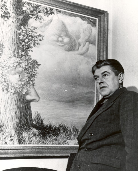 René Magritte in front of Alice in Wonderland, c. 1958