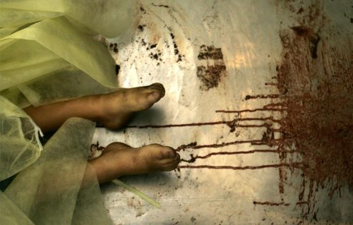 """The feet of one of three Palestinian siblings from the Al-samoni family, killed by an Israeli tank shell, are seen in the mortuary of Al-Shifa hospital, on January 5, 2009 in Gaza City. Seven members from the Al-samoni family were killed including the mother, three children and a baby, when an Israeli shell struck their house south of Gaza city.""  (Abid Katib/Getty Images)"