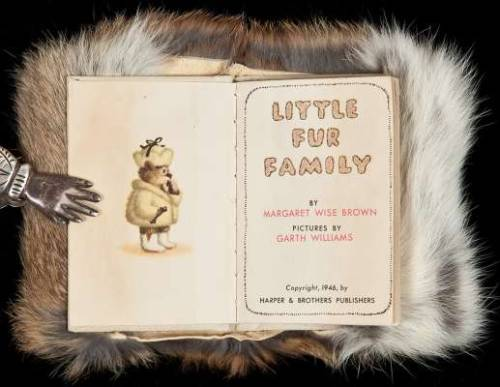 "Little Fur Family Brown, Margaret Wise New York, 	Harper & Bros. 1946.  Color illustrations by Garth Williams. 8.2x5.6 cm. (3¼x2¼""), original white paper boards with color pictorial front cover, fur cover, original two part box with a circular hole in the middle of the furry animal on the front part with actual fur showing through. First Edition. An unusual children's book, which still has the rabbit fur book cover. Later printings were substituted with an artificial fur cover.  B-A Note: I seriously debated whether to post this.  A children's book about furry animals, bound in real fur?  What were they thinking?"