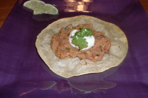 Tostadas Ingredients: 2 tablespoons vegetable oil, plus extra for frying 1 onion, finely chopped 2 garlic cloves, chopped 1/2 teaspoon chile powder 14 ounce can pinto beans, drained 2/3 cup vegetable stock 1 tablespoon tomato paste 2 tablespoons fresh cilantro, chopped 6 corn tortillas Sour cream, cheddar cheese, salsa, etc to put on top Directions: Heat 2 tablespoons of oil in a heavy-based frying pan and fry the chopped onion for 3-5 minutes, until softened. Add the garlic and chili powder, and fry for 1 minute, stirring constantly. Add the beans. Pour the stock in and mix well. Mash the beans very roughly.  Add the tomato paste and chopped cilantro. Mix thoroughly and cook for a few minutes. Heat oil in a high-rimmed frying pan. One at a time, fry the corn tortillas for about 1 minute, turning once, then place them on a paper towel to drain. Put a spoonful of refried beans on each tostada, and add your choice of toppings. Enjoy. <3