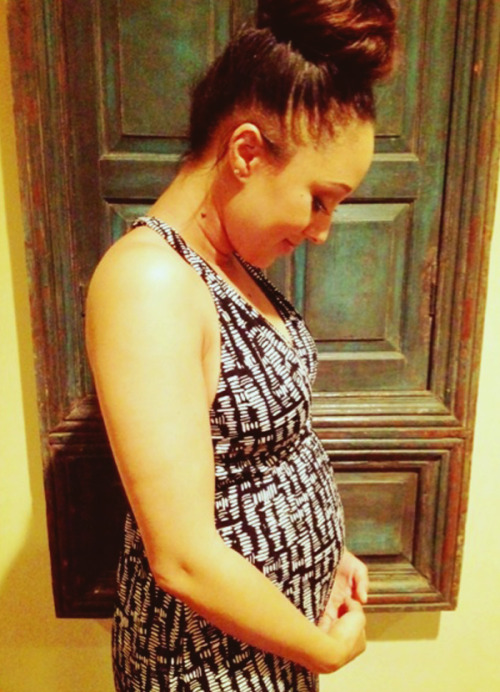 "loveandjealousy:   ""Loving my baby bump. I'm obsessed with rubbing it."" Tamera Mowry-Housley"