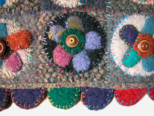 "FORGET ME NOT NINE-PATCH (detail): 2002. Felted wool made from recycled sweaters, vintage buttons, wool thread; 13"" x 13""."