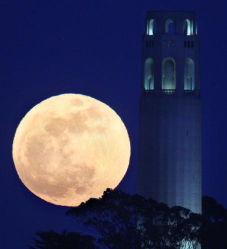Supermoon rising beside Coit Tower, San Francisco. May 5, 2012.