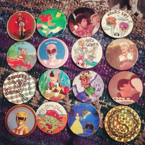oldfilmsflicker:  oceanaroll:  Found my pogs #90s (Taken with instagram)  man I used to have sooooo many pogs  This is a wonderful, wonderful image.