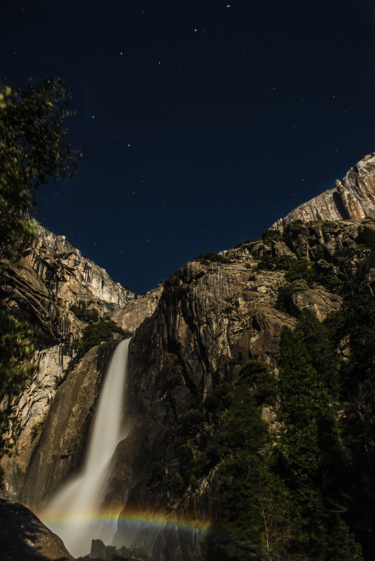 photojojo:  Moonbow: a rainbow made by the light of the moon. Our pal Mcheung tells us all about how he shot this one this past weekend!  This weekend was the best moonbow-photographing weekend of the year!   A moonbow is essentially the same thing as a rainbow, except that it happens at night.  It's a pretty rare phenomenon that only occurs in a few places on earth.  Photos of Super Moon Rainbows