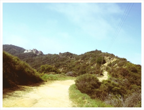 "I LOVE MONDAYS. For cycling, that is. See that portion of the trail up there? It's the last, super-steep push up to ""The Hub"" in the Santa Monica Mountains. It usually has at least a hiker or two plus another cyclist sweating it out on that thing. But this was shot on a Monday morning, which means it's mine all mine. See, the conventional, traditional and accepted cycling schedule is: Tuesday is a light day.  Wednesday gets a little more intense.  Thursday is time to push it hard, throw in some intervals.  Friday is a day to loosen up the legs and prepare for the longer weekend rides.  Saturday and Sunday are race days – or simply long and longer rides. Monday is a rest day. Unless you're me – the non-racer. Monday means I usually have the trails or roads to myself out there. And as much as I love to do small group rides, after a weekend with the family and its accompanying noise and hyper-stimulation of all senses, a little alone, quiet time on the bike is just what the Dr. ordered. For just this one day, anyway. I'm not that anti-social. Yeah, I still intensely dislike a lot of the expected things about Mondays, but in the spirit of accentuating the positive, I'm gonna latch onto this. I recommend you do the same. See you out there. Or perhaps not. Nothing personal. - Brian"