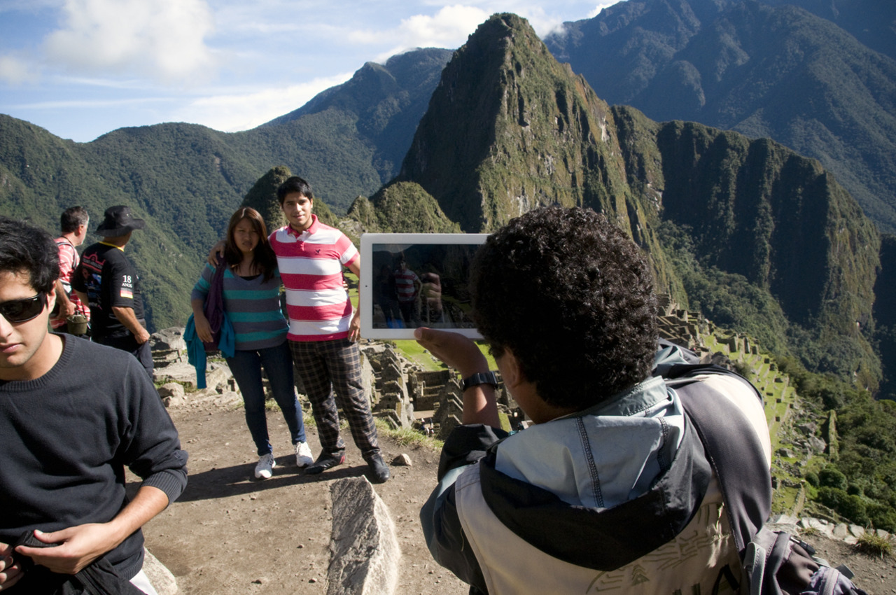 Your iPad is blocking my view Machu Picchu, Peru - © Diego Cupolo 2012