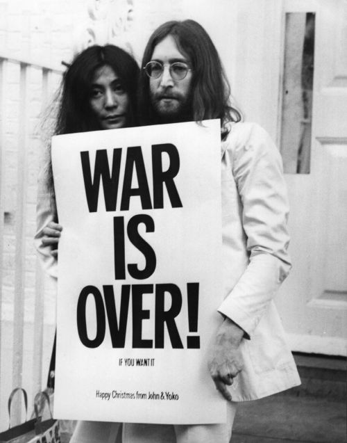 Yoko Ono and John Lennon with peace campaign poster against the Vietnam War, 1969. | Photographed by Frank Barratt.