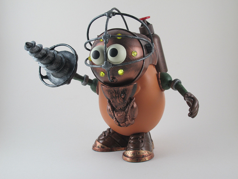 ianbrooks:  Big Potato Daddy by Ginger Troll Mr. Potato Head goes to Rapture with this customized Big Daddy diving suit, complete with light-up faceplate. Would you kindly rearrange your face, Mr. Bubbles?  Artist: flickr (via: colorofinsanity / kotaku)