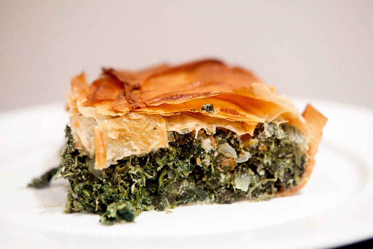 Spanakopita Pretty simple recipe for a spinach pie, you can improvise and try some other cheese as well, or just more of it, can't really go wrong with this one. Ingredients: 1 onion, diced 4 garlic cloves Half bunch of chopped fresh thyme leaves 750g frozen spinach 200g feta cheese 4 eggs Juice of 1 lemon 1 tbsp dukkah 1 tsp nutmeg Salt, pepper, cayenne, olive oil 10 sheets filo dough Melted butter Mash garlic with salt in a mortar and pestle, and sauté in olive oil.  Mix in the thyme for the last minute.  Thaw spinach and squeeze out all the liquid.  Mix with the onion mixture, feta, nutmeg, and lemon.  Season with salt and pepper.  Beat the eggs and combine. Brush a 9x9 inch glass dish with melted butter, and layer on dough, alternating angles, brushing with butter in between each sheet.  Put the spinach mixture in the middle, top with a bit of cayenne and the dukkah.  Fold over the filo onto the top to cover, brushing with butter as you go so it's all covered.  Bake at 200C / 375F for 45 minutes