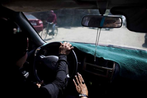 A young woman learns to drive at the Motor Vehicle Driving School in Kabul. Photo: Jonathan Saruk. The war in Afghanistan is not over. Help us tell the story. Fund our Kickstarter.
