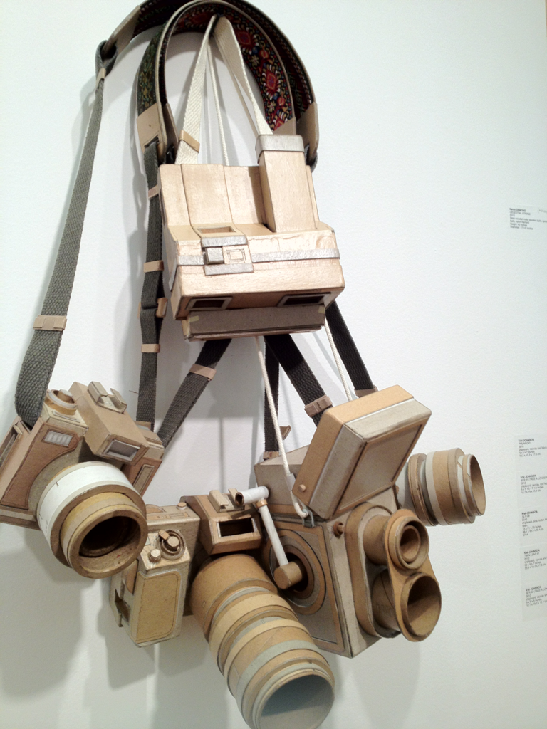 Found at Pulse New York: A Series of Chipboard Cameras by Kiel Johnson. Materials: Chipboard, canvas, fabric.