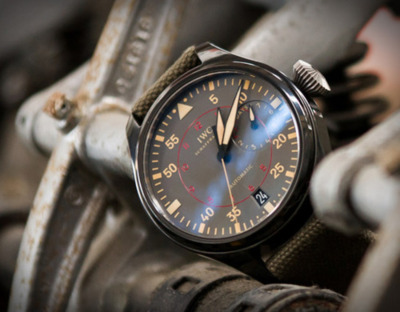 IWC Big Pilot Top Gun Miramar Line The new Miramar line with its polished ceramic case, hands and chapter ring in beige, and green textile strap was inspired by the colour and material range typically favoured by the military. Thanks to the 51111 calibre, the largest manufactured in-house by IWC, the watch will continue running for a week when fully wound. The sapphire glass is secured against drops in pressure in the cockpit.
