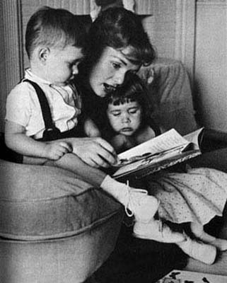 Debbie Reynolds reads to the kids.
