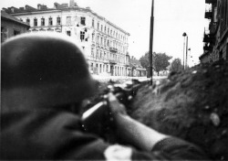 fortysixand-two:  A member of the Armia Krajowa with a rifle in firing position, Warsaw 1944.
