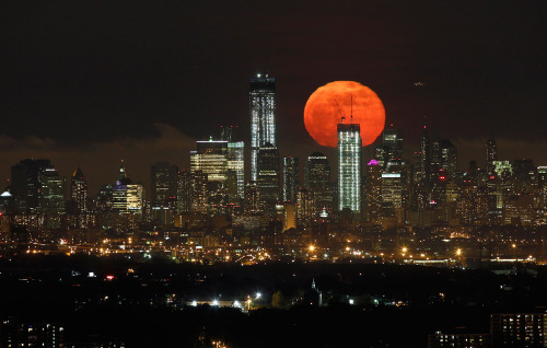 atlanticinfocus:  From Supermoon 2012, one of 23 photos. Here, the full moon rises over the skyline of Lower Manhattan and One World Trade Center in New York, as seen from West Orange, New Jersey, on May 6, 2012. (Reuters/Gary Hershorn)