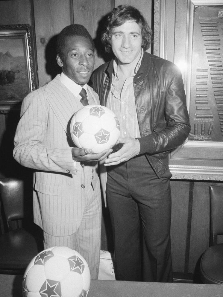 "Pele and Chinaglia, 1976. Two football sharpshooters, with ammo casings fittingly displayed within a bulky frame nearby. I'd say Giorgio was a Winchester Model 12 pump shotgun type, in its time, it was the shotgun against which all others were measured. Meanwhile, Pele would be more like the legendary pre-1964 Winchester Model 70 which Field & Stream rates as the best rifle ever made one in that ""never before and probably never again will we see such a combination of accuracy, reliability, grace, and mystique."" That sounds just about right. Source: Bild.de"