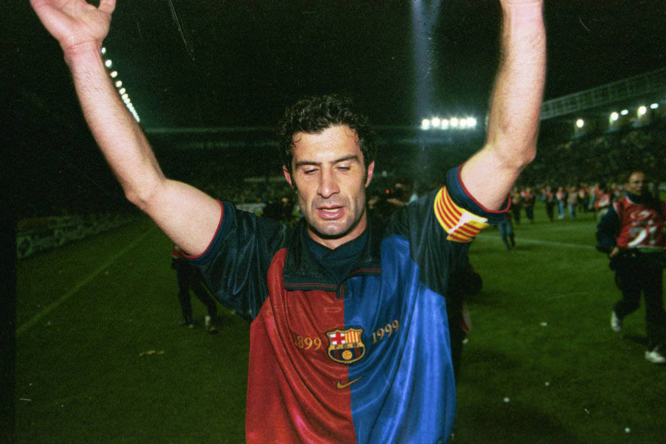 Barcelona captain Luis Figo acknowledges the traveling support at the Mendizorroza in Alaves, after securing the 1999 Spanish league with a 4-1 victory over the home club. May 22, 1999. Source: Mundo Deportivo