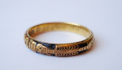 maudelynn:  A rare early 18th century Memento Mori band gold known as a skeletal, as the whole length of the skeleton is employed on the outside of the hoop, with other emblems. The earliest known example is dated 1659. This ring is enamelled in black with a full skeleton, twin hearts for love and an hourglass, symbolic of the passage of time and the brevity of life.