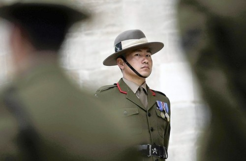 Nepal's fierce Gurkha soldiers find themselves under siege: Some in Nepal's communist-led government object to the fighters' connection to the British military and want to cut ties. The relationship dates to 1815. Photo: Nepalese Gurkhas stand guard outside St. George's Chapel in Windsor, England. Some in Nepal object to the troops' two-century-old ties to Britain. Credit: Leon Neal / Pool