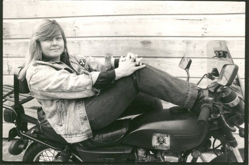 Please enjoy this picture of denim-clad Dorothy Allison lounging on a motorcycle