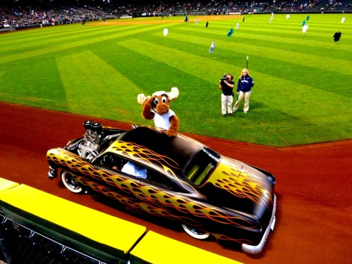 The Mariner Moose taking a ride around the field in a classic '50s Hot Rod to promote Turn Back the Clock Night on May 26th.