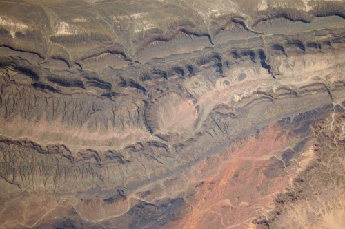 Ouarkziz Impact Crater in Algeria. This crater (3.5 km wide) was formed by a meteor impact less than 70 million of years ago.