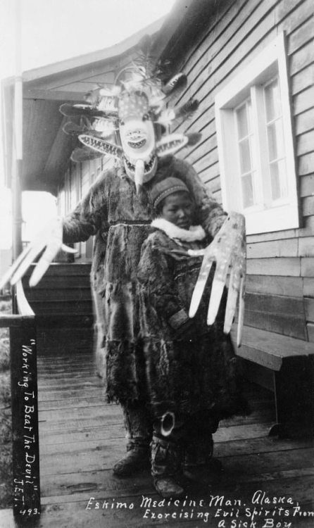 "invisicollege: ""Eskimo Medicine Man, Alaska. Exorcising evil spirits from a sick boy."""