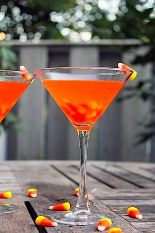 Candy Corn Martini - infuse 3/4 c. candy corn with 1 c. vodka for about 3 hours (until bright orange). Shake with 1/4 c. butterscotch schnapps and ice. Pour over a few candy corns in a martini glass. I don't think my teeth could handle this drink but it looks very festive so I might try it.