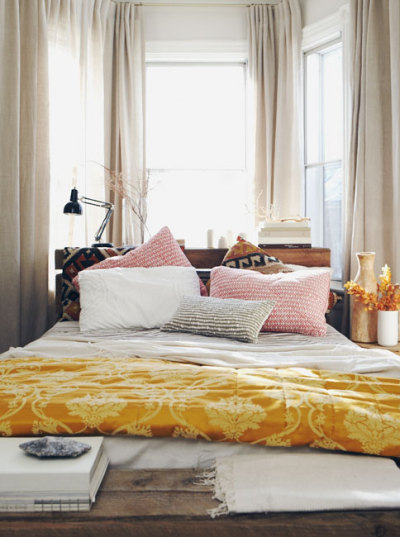 anthropologie:  Loving the mix of prints and textures in this pretty sun-filled bedroom. Via: Michael Graydon Photography