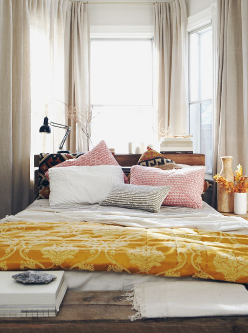 ktprettyideas:  Fun/cozy/summer inspired bedroom decor  anthropologie:  Loving the mix of prints and textures in this pretty sun-filled bedroom. Via: Michael Graydon Photography