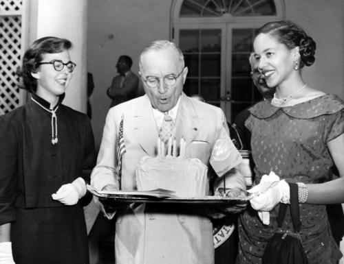 President Truman with United Nations Cake Birthday cake presented to President Harry S. Truman (center) by members of the National Citizens Committee for United Nations Day. The cake is to celebrate the sixth anniversary of the United Nations. The cake is made from a recipe of Mrs. Bess Wallace Truman's that is in the United Nations cookbook, sponsored by the Committee. 9/12/51