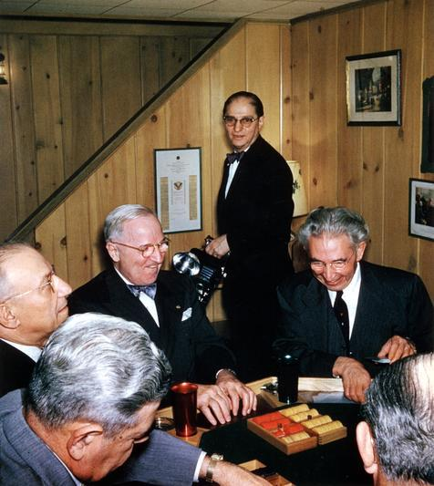 "Harry S. Truman at a Surprise Poker Party Photo: Surprise poker party at the home of A. J. & Mildred Granoff, on the occasion of A. J. Granoff's 60th birthday. Seated at the poker table in the lower left hand corner are: Frank Rope, A. D. ""Doc"" Jacobson, former President Harry S. Truman, Hy Vile (standing), A. J. Granoff, and Harry Small. 2/22/56. -from the Truman Library"