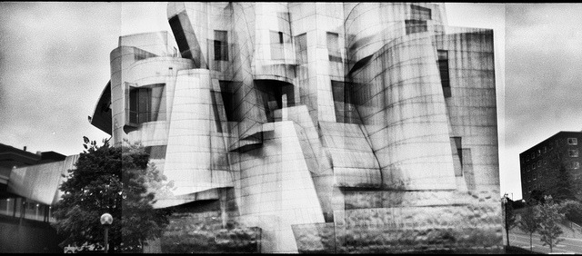 The Weisman Art Museum: A Holgarama on Flickr.Holga BC135 | Kodak Plus-x | XTOL (1:1) | post-processed in Topaz Adjust I'm fascinated by the intersection of analog and digital technology. There's nothing like shooting with a film camera and the freedom that digital processing affords allows a lot of creativity once your negative is scanned. I'm not going to get into the digital vs. film debate because I think both have their place in a photographer's toolbox. For this shot, I decided to embrace the Weisman Art Museum's wonderful curves, Holga's dreamy lens and ability to overlap frames, and the power of tonemapping, which highlights local contrast most often used in digital camera photos. It's a tool best used minimally, but for the dreamy, unfocused, and overlapping look this image already possessed, I thought it worked out very well!