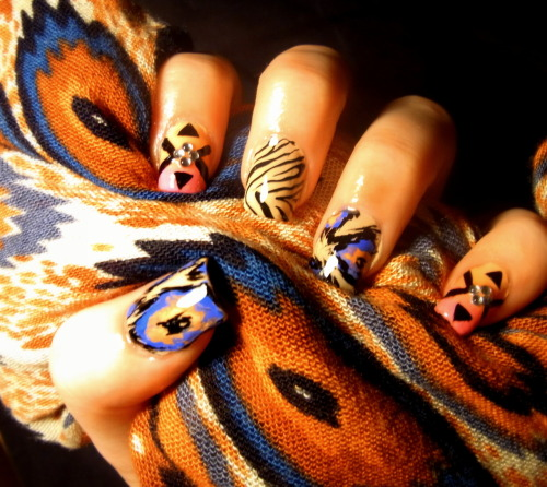 omgnailart:  First stab at ikat print, inspired by my new scarf, along with a recreation of one of SuPa Nails' designs and some zebra print :)