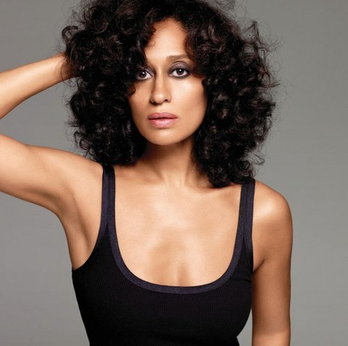 I LOVE her hair in this picture. Almost makes me want to go natural. Almost.
