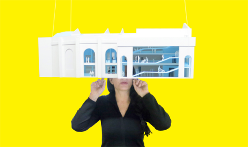 Marina Abramovic with a model of the OMA-designed Marina Abramovic Institute.