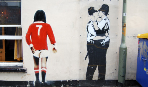 "Banksy's Kissing Policemen Voted ""The"" Quintessentially British Artwork"