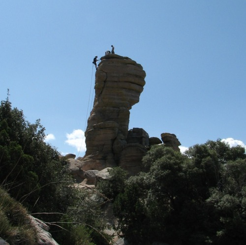 Climbers on a spur of rock on Mt Lemmon in Coronado National Forest outside Tucson, AZ.