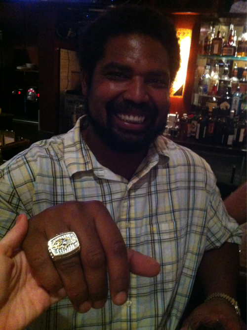 My hand is tiny next to my high school classmate Jonathan Ogden's. He retired from the Baltimore Ravens after a stellar football career, including a Super Bowl win.