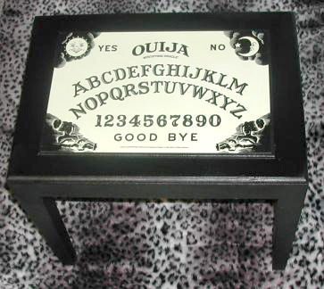 Ouija Board Table by Hell in a Handbag. I love this table and, if you're handy, it would be really easy to make your own similar to this or even paint on your own version of a Ouija board. Plus, it would look cool year round.