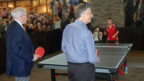 Bill Gates and Warren Buffett playing ping pong at a Berkshire Hathaway shareholders meeting. So much awesomeness.