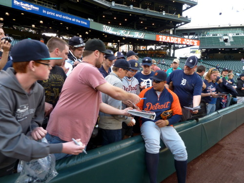 Miguel Cabrera signs autographs for fans in Seattle.