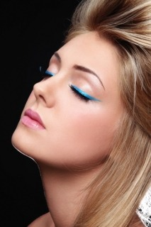 Swap your regular black eyeliner for a bright blue one this Summer.