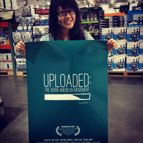 Julie with our official Uploaded documentary poster. Fresh off the press. Can't wait to frame one! Whoo. :)
