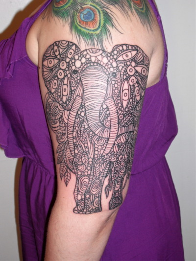 fuckyeahtattoos:  Elephant. Cara Cable, Black Cat Tattoos, Pittsburgh, PA. First session, three hours. Based off of this (and will eventually look something like that with similar colors as a complete half-sleeve): http://imgur.com/a/u4vyM Side views, as taken by my artist: http://instagr.am/p/KV9ZbAIZlh/