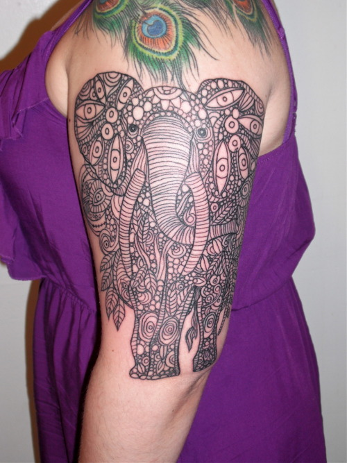 Elephant. Cara Cable, Black Cat Tattoos, Pittsburgh, PA. First session, three hours. Based off of this (and will eventually look something like that with similar colors as a complete half-sleeve): http://imgur.com/a/u4vyM Side views, as taken by my artist: http://instagr.am/p/KV9ZbAIZlh/