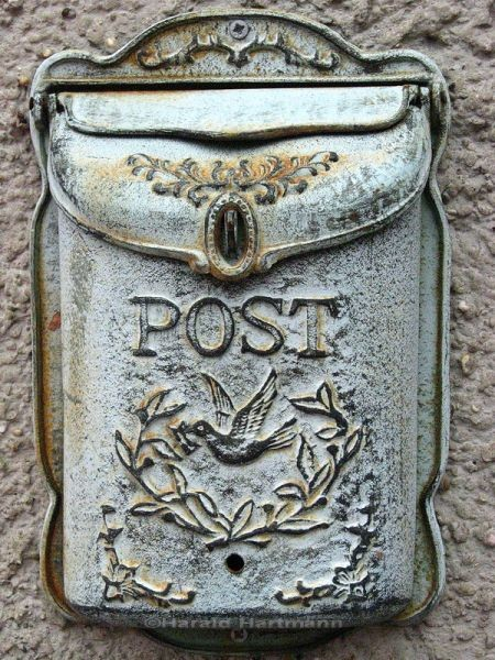 teachingliteracy:postagedue: A postbox with a beautiful patina and tiny bird carrying a letter/envelope.