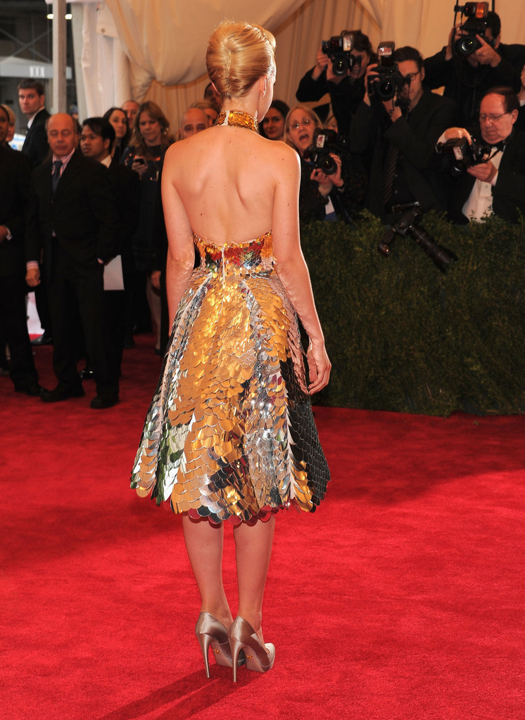 suicideblonde:  Carey Mulligan in Prada at the Met Costume Gala, May 7th I am completely baffled as to why Carey was on some worst dressed lists, because this dress is a work of art.  Scales of mirrors!  And her makeup and hair was so sleek, perfectly matched to the dress.